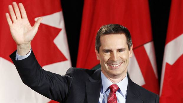 Liberal Leader Dalton McGuinty waves to supporters at his Ontario election night headquarters in Ottawa on Oct. 6, 2011.