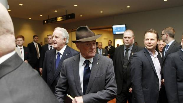Barrick Gold Corp. chairman Peter Munk arrives at the Metro Toronto Convention Centre on Wednesday, April 24, 2013, for his company's annual general meeting. Behind to his right, Barrick board member and former prime minister Brian Mulroney. (Fernando Morales/The Globe and Mail)