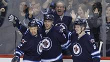 Winnipeg Jets' Olli Jokinen, Blake Wheeler and Jacob Trouba celebrate Wheeler's goal against the Phoenix Coyotes during first period NHL action in Winnipeg on Thursday, February 27, 2014. (JOHN WOODS/THE CANADIAN PRESS)