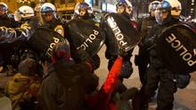 Protesters are confronted by police as they march against student tuition hikes in downtown Montreal, Quebec April 27, 2012. (CHRISTINNE MUSCHI/REUTERS)