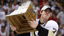 Pittsburgh Penguins forward Evgeni Malkin hoists the Conn Smythe Trophy after defeating the Detroit Red Wings in Game 7 of the NHL Stanley Cup final. (SHAUN BEST/Shaun Best/Reuters)