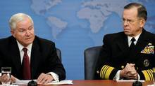 US Defense Secretary Robert Gates, left, and Chairman of the Joint Chiefs Admiral Mike Mullen speak during a press conference at the Pentagon in Washington. (Jim Watson/AFP/Getty Images)