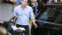 Britain's Prince William carries his baby son in a car seat, as he leaves the Lindo Wing of St Mary's Hospital with his wife Catherine, Duchess of Cambridge, in central London July 23, 2013. Kate gave birth to the couple's first child, who is third in line to the British throne, on Monday afternoon, ending weeks of feverish anticipation about the arrival of the royal baby. (CATHAL MCNAUGHTON/REUTERS)