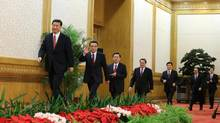 China's new leaders arrive for a press conference after being elected members of the Standing Committee of the Political Bureau of the 18th Central Committee of China's Communist Party at the Great Hall of the People in Beijing Thursday, Nov. 15, 2012. (Ding Lin/AP)