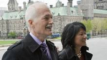 NDP chief Jack Layton arrives on Parliament Hill with his wife, Toronto MP Olivia Chow, to be sworn in as Leader of the Official Opposition on May 18, 2011. (PATRICK DOYLE/THE CANADIAN PRESS)