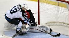 Winnipeg Jets' Kyle Wellwood (13) scores the winning goal in a shootout against Florida Panthers goalie Jose Theodore, background, in an NHL hockey game in Sunrise, Fla., Monday, Oct. 31, 2011. The Jets won 4-3. (Alan Diaz/AP)