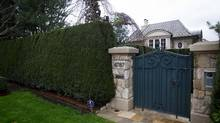 A mansion that sold for $51.8-million is seen on Drummond Drive, in Vancouver, B.C., in this file photo. (DARRYL DYCK For The Globe and Mail)