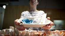Registered nurse Sammy Mullally holds a tray of supplies to be used by a drug addict at the Insite clinic in Vancouver on May 11, 2011. (JOHN LEHMANN/THE GLOBE AND MAIL)