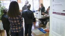 Voters wait to collect their ballots for Canada's federal election at an advanced polling station in Toronto on Friday, October 9 , 2015. (Chris Young/The Canadian Press)