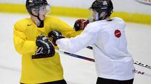Canada's Ryan Nugent-Hopkins,l(left) from Burnaby B.C., roughs around with, Nathan McKinnon, from Cole Harbour, N.S., during practice for the World Juniors team in Calgary on Saturday Dec. 15, 2012. THE CANADIAN PRESS/Larry MacDougal (Larry MacDougal/THE CANADIAN PRESS)