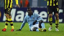Manchester City's Mario Balotelli sits on the pitch during their Champions League group D soccer match against Borussia Dortmund in Dortmund December 4, 2012 (INA FASSBENDER/REUTERS)