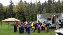 A team leader briefs volunteers at the Terrace Search and Rescue command vehicle off Highway 16, near Princess Lake, on Sept. 29, 2013. The search for Ike Murray, 26, and Michael (Devlin) Sabo, 32, was suspended that night. (Dave Jephson/Courtesy Terrace Search and Rescue)