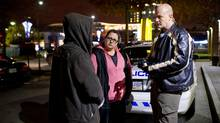 Tina Baker, middle in pink, and Constable Greg Bakker, far right, respond to a call involving a man known to have a mental health history at a McDonald's in Surrey, B.C. (Jimmy Jeong/jimmyshoots.com)