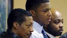 Ma'lik Richmond, stands with his father, Nathaniel Richmond, left, and attorney Walter Madison in Juvenile Court in Steubenville, Ohio March 17, 2013. Two high school football players from Ohio, Trent Mays, 17, and Richmond, 16, were found guilty of raping a 16-year-old girl at a party last summer. (POOL/REUTERS)