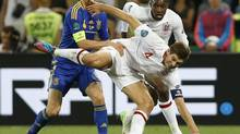 England's Steven Gerrard, center, is challenged by Ukraine's Anatoliy Tymoshchuk during the Euro 2012 championship Group D match between England and Ukraine in Donetsk, Ukraine, Tuesday, June 19, 2012. (Kirsty Wigglesworth/AP)
