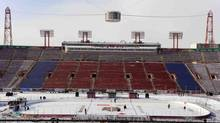 Ice makers work on the ice at McMahon Stadium which will host the NHL Heritage Classic in Calgary, Alberta, February 17, 2011. (TODD KOROL/REUTERS)