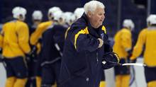 Ken Hitchcock skates on the ice during his first practice after being named head coach of the St. Louis Blues hockey team Monday. (Jeff Roberson/Associated Press)