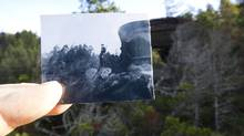 An old photo of a searchlight emplacement on Yorke Island is held up in the same spot more than 70 years later on Nov. 7, 2011. (JOHN LEHMANN/JOHN LEHMANN/THE GLOBE AND MAIL)