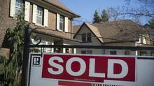 A sold sign is shown in front of west-end Toronto homes Sunday, April 9, 2017. CREA said home sales over its MLS system increased by 1.1 per cent for March to top the previous monthly record set in April 2016. (Graeme Roy/THE CANADIAN PRESS)