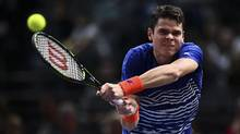 Milos Raonic plays a backhand against Pablo Carreno Busta of Spain during their second-round match at the Paris Masters on Nov. 1, 2016. (Dan Mullan/Getty Images)