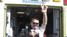 Veteran Pascal Lacoste flashes a peace sign as he is loaded on an ambulance, ending his hunger strike in front of Veterans Affairs Minister Steven Blaney's local riding office, Tuesday, November 8, 2011 in Levis, Que. (Jacques Boissinot/THE CANADIAN PRESS/Jacques Boissinot/THE CANADIAN PRESS)
