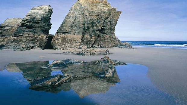 "Explore the ""beach of the cathedrals,"" known locally as Playa de las Catedrales on the Cantabric coast. (TourSpain)"