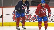 Montreal Canadiens George Parros takes part in an informal practice as the team opens its rookie training camp Thursday, September 5, 2013 in Brossard, Que.. (RYAN REMIORZ/THE CANADIAN PRESS)
