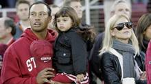 In this Nov. 21, 2009 file photo, Tiger Woods with his daughter Sam and wife Elin are seen before the start of a NCAA college football game between Stanford and California in Stanford, Calif. (Marcio Jose Sanchez)