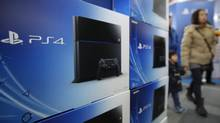 Boxes sit on display for Sony Computer Entertainment Inc.'s PlayStation 4 (PS4) video game console at a Bic Camera Inc. electronics store in Tokyo, Japan, on Saturday, Feb. 22, 2014. (Kiyoshi Ota/Bloomberg)