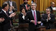 Liberal leader Michael Ignatieff, centre right, receives a standing ovation while introducing his party's non-confidence motion in the House of Commons on Parliament Hill in Ottawa March 25, 2011. (CHRIS WATTIE/CHRIS WATTIE/REUTERS)
