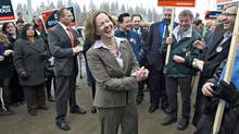 Progressive Conservative Leader Alison Redford has a laugh with supporters as the Alberta election kicks off in Edmonton on March 26, 2012. (JASON FRANSON/Jason Franson/The Canadian Press)