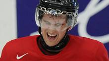 Canada's Mark Stone reacts to getting hit on the hand with a stick during practice at the 2012 IIHF U20 World Junior Hockey Championship in Calgary, Alberta, January 2, 2012. REUTERS/Todd Korol (TODD KOROL)