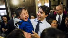 Prime Minister Justin Trudeau greets residents of the Mon Sheong Court Senior Home in Markham, Ont., Thursday, March 23, 2017. (Christopher Katsarov/THE CANADIAN PRESS)