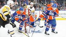 Andrej Sekera and Oscar Klefbom of the Oilers defend against Nick Bonino of the Penguins on March 10, 2017 at Rogers Place in Edmonton. (Codie McLachlan/Getty Images)