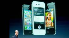 Tim Cook, chief executive officer of Apple Inc., speaks in front of an image of the iPhone 4S during an event at the company's headquarters in Cupertino, California, U.S., on Tuesday, Oct. 4, 2011. (David Paul Morris/David Paul Morris/Bloomberg)
