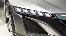 Front end light treatment of the Acura NSX hybrid concept car (MIKE CASSESE/REUTERS/Mike Cassese)