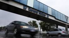 Cars pass under an overpass at the General Motors Car assembly plant in Oshawa, June 1, 2012. (Mark Blinch/Reuters)