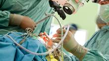 A stock photo of doctors performing brain surgery. (VILevi/Getty Images/iStockphoto)