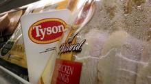 Tyson Foods chicken products are displayed on the shelves of a Little Rock, Ark. grocery store. Springdale, Ark.-based Tyson forecast a 1-per-cent decline in overall domestic protein production, including chicken, beef, pork and turkey, for its full fiscal year. (Danny Johnston/AP)