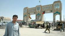 Iltaf Shah, 34, a Pakistani engineer, works just inside enormous gates that mark the Afghan border. Afghans have started making rude comments to the Pakistanis who visit, he said, as they grow angry about a border dispute. (Graeme Smith / The Globe and Mail 2005)