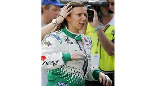 Simona De Silvestro prepares to drive during practice on the first day of qualifications for the Indianapolis 500. Her hands were burned in a crash two days earlier. To numb the pain, doctors have used