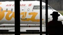 Jazz employs more than 1,500 pilots and nearly 880 flight attendants. The two unions' last collective agreement expired June 30, 2009. (JOHN LEHMANN/The Globe and Mail)
