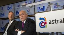 BCE CEO George Cope, left, and Ian Greenberg, CEO of Astral Media Inc., speak at a news conference in Montreal on March 16, after BCE agreed to acquire Astral. (CHRISTINNE MUSCHI/REUTERS)