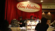 Tim Hortons shareholders line up at a Tim Hortons stand during the company's AGM on May 10, 2013. (Fernando Morales/The Globe and Mail)