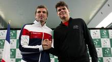 French tennis player Julien Benneteau, left, and Canadian Milos Raonic, of Toronto, Ont., pose for photographs during the draw for the Davis Cup in Vancouver, B.C., on Thursday February 9, 2012. Canada and France are scheduled to play in Davis Cup tennis matches Feb. 10-12 in Vancouver. (DARRYL DYCK/THE CANADIAN PRESS)