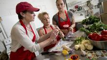Judy Hume, left, from Fresh Canteen along with Vanda Boaventura and Taylor Wild prepare food in Toronto for recipe boxes. Fresh Canteen offers subscribers all of the ingredients needed to make as many meals as customers require along with recipes and step-by-step photo instructions. (Kevin Van Paassen for The Globe and Mail)