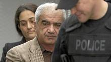 Mohammad Shafia (front) and Tooba Yahya are escorted into the Frontenac County courthouse in Kingston, Ontario on Friday, January 27, 2012. (Frank Gunn/THE CANADIAN PRESS)