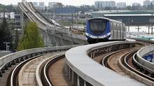 A SkyTrain pulls into Marine Drive station in Vancouver on August 13, 2012. (Jeff Vinnick for The Globe and Mail)