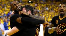 LeBron James (left) and Kevin Love (middle) of the Cleveland Cavaliers celebrate after defeating the Golden State Warriors 93-89 in Game 7 of the 2016 NBA Finals at ORACLE Arena on June 19, 2016 in Oakland, California. On December 1, 2016, James was named Sports Illustrated's Sportsperson of the Year, claiming the award the the second time. James also won in 2012 as a member of the Miami Heat. (Ezra Shaw/Getty Images)