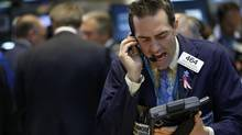 Trader Greg Rowe of Livermore Trading works on the floor at the New York Stock Exchange on April 25, 2013. Stocks rose on Thursday, following upbeat earnings and better-than-expected reports on U.K. economic growth and U.S. initial jobless claims. (BRENDAN MCDERMID/REUTERS)